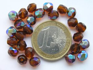 0030209 Dark Topaz facet met AB 6 mm.-0