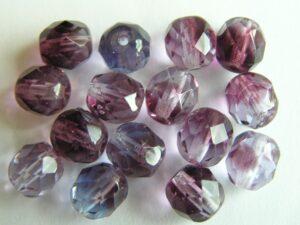 0080572 Amethyst met transparant en tanzanite gemeleerd, facet 8-0