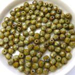 0100471 Opaque green met Travertin facet 4 mm.-0