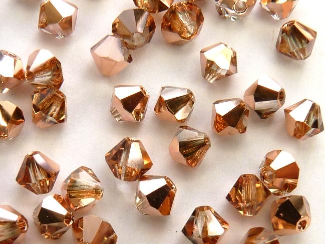 03-MC-00010-27101 Bicones Crystal Capri Gold 50 Pc-0