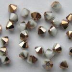 04-MC-03000-27101 Bicone, White Chalk Capri Gold 4 mm. 50 Pc.-0