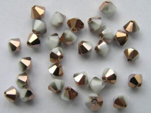 04-MC-03000-27101 Bicone, White Chalk Capri Gold 4 mm. 50 Pc.-0
