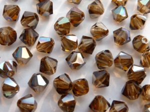 04-MC-10220-22501 Bicone, Smoke Topaz Celsian 4 mm. 50 Pc.-0