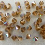 04-MC-10220-28701 Bicones Smoke Topaz AB 4 mm. 50 Pc.-0
