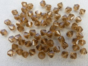04-MC-10220 Bicones Smoke Topaz 4 mm. 50 Pc.-0
