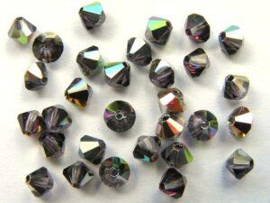 04-MC-20500-28136 Bicone, Tanzanite Vitrail 4 mm. 50 Pc.-0