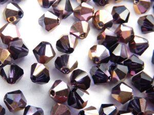 04-MC-20510-27101 Bicone, Tanzanite Capri Gold 4 mm. 50 Pc.-0