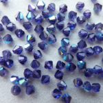 04-MC-20510-28701 Bicones Tanzanite AB 4 mm 50 Pc-0