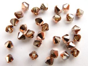 04-MC-10220-27101 Bicone, Smoked Topaz Capri Gold, 4 mm. 50 Pc.-0