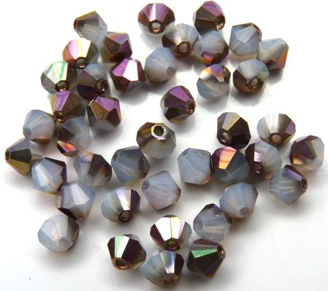 04-MC-01000-27101 Bicone, White Opal Capri Gold 4 mm. 50 Pc.-0