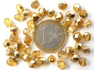 0150168 Crystal Half Dorado Facet 6 mm. 25 Pc.-0