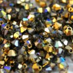 03-MC-00010-98536 Crystal Golden Rainbow Bicone 3 mm. 50 Pc.-0