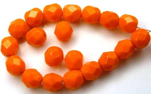 0060114 Opaque Mandarin Orange facet 6 mm. 25 Pc.-0