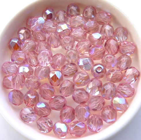 0070319 Coated Milky Pink AB facet 6 mm. 25 Pc.-0