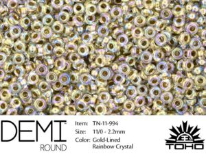 TN-11-0994 Demi Round TOHO Gold-Lined Raimbow Crystal-0