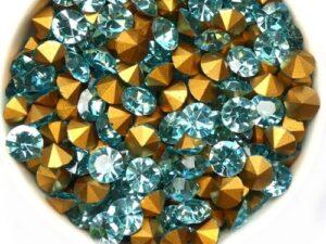 SS29-MCC-60010-98521 Aqua Gold Foiled Chaton 6 mm. 12 Pc.-0