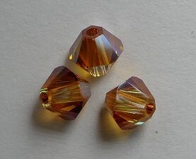 SW-04-CRYSAPR 5328 Crystal Apricot Swarovski Bicone 4 mm 40 Pc.-0