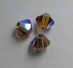 SW-04-LTSMTOAB2 5301 Light Smoked Topaz AB2x Swarovski Bicone 4 mm. 40 Pc.-0