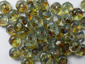 0020013 Crystal Travertin Donut Facet 6 x 4 mm. 25 Pc.-0